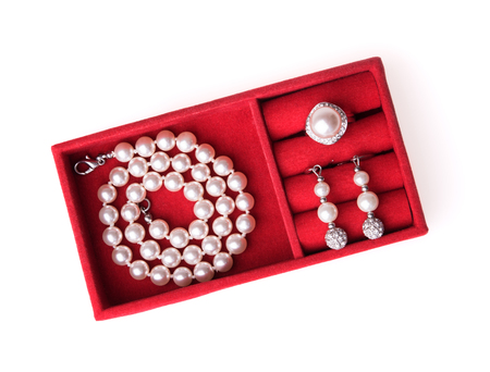 chest women: Jewelry box with pearl necklace, ring and ear-rings, white background
