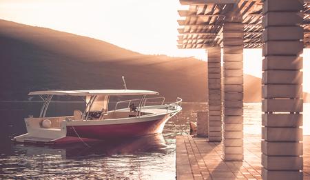 motor boat: Motor boat near pier on calm sea, sunset. Vintage toning