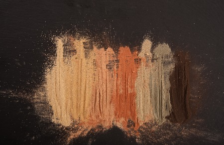 white mask: Set of multicolored cosmetic clay on black stone board