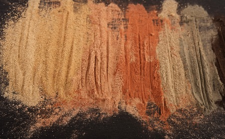 Set of multicolored cosmetic clay on black stone board