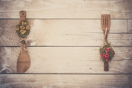 utencils: Wooden background with kitchen utencils, vintage toning Stock Photo