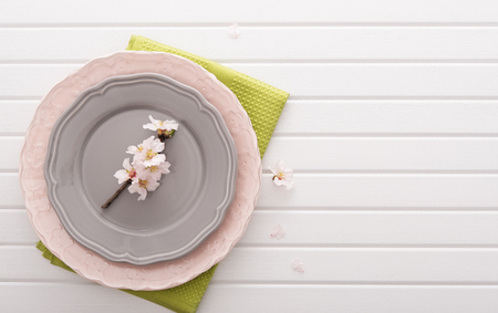 plates of food: Top view on table with plates and flowers