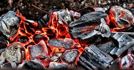Closeup on bright burning coals after bonfire
