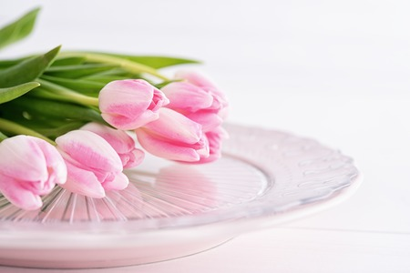 Closeup of pink tulips on pink plate
