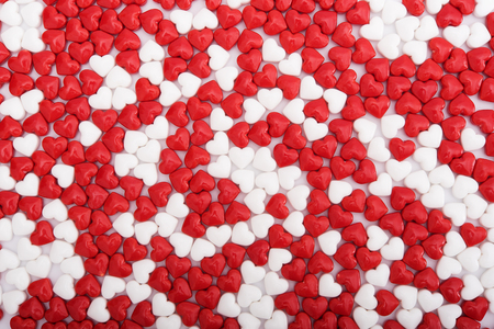 Background from red and white bonbons in shape of heart Imagens