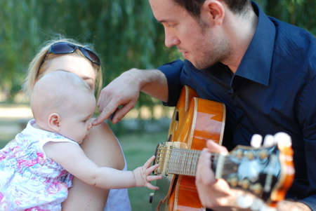 girl playing guitar: Baby with guitar Stock Photo