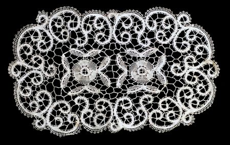 Piece of belgian lace, on a black background. 版權商用圖片 - 861924