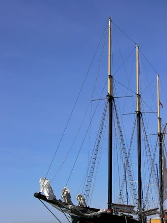 Masts, sails and rigging on a tall ship.