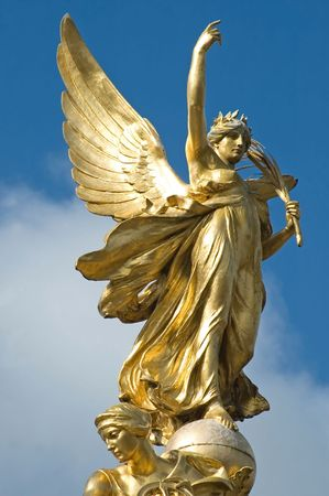 Golden angel on the top of the Victoria Memorial, Buckingham Palace, London.