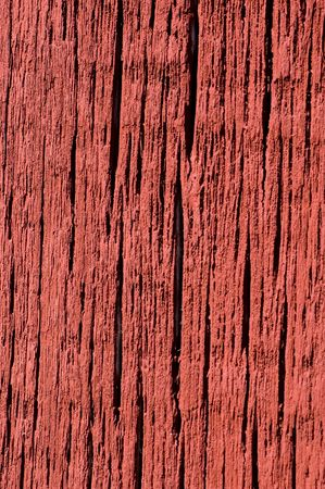 barn board: Bright red paint on weathered barn board.