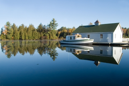 Smooth clear lake and fall colors - great cottage country. Stock Photo