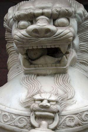 Lion guarding a bank in Shanghai.