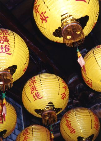 Colorful lanterns decorate the ceiling of a temple in Taiwan.