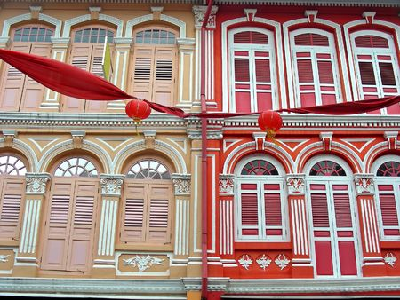 Brightly colored architecture - Shop Houses in Singapores Chinatown. Stock Photo