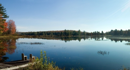 A calm clear lake in Muskoka, Ontario, Canada, first thing in the morning.