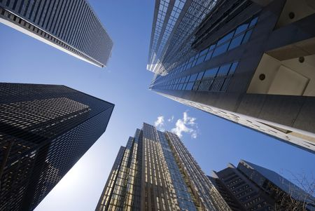 Looking up into the bright blue sky, from amidst a forest of skyscrapers - Toronto, Canada.