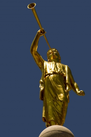 The golden statue of the angel Moroni on top of the Mormon temple, Salt Lake City, Utah.