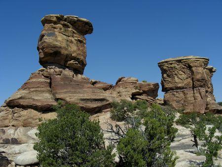 hoodoos: Hoodoos looking like a set of top hats - Canyonlands National Park, Moab, Utah.