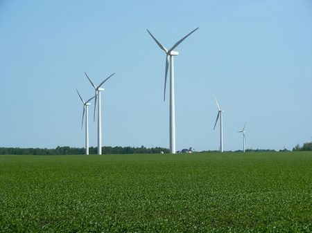 A windpower farm, literally, wind turbines on a farm, Southern Ontario. Stock Photo - 3375288