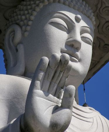Buddha, giving a blessing, at a temple in Seoul, Korea.           Stock Photo