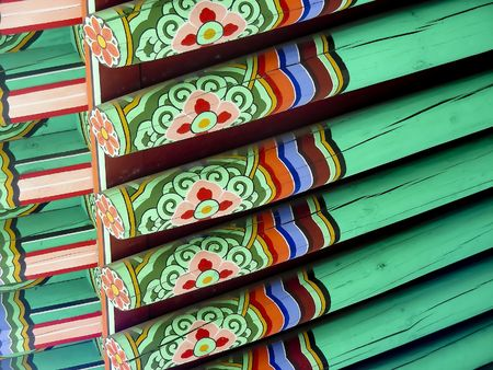 Typical Korean historic design on the roof of a palace gate in downtown Seoul, Korea.