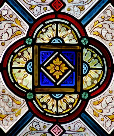 Pretty pattern in a stained glass window - a church in Cornwall, England.           Stock Photo
