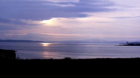 Sunrise over the mainland of Scotland as viewed from the Isle of Mull.