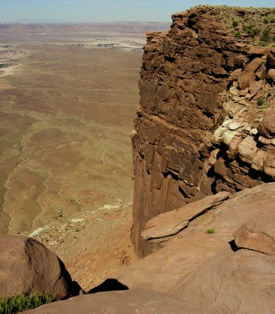 Looking out from the top of a cliff over the Utah desert.