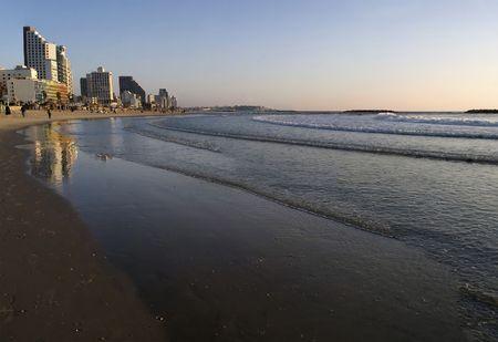 Sunset over the Mediterranean, along the beach at Tel Aviv, Israel. photo