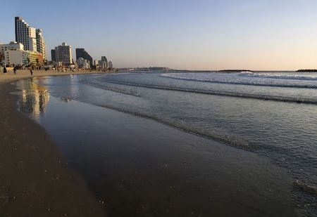 vista: Sunset over the Mediterranean, along the beach at Tel Aviv, Israel.