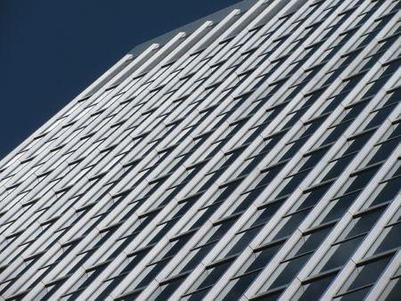 brighten: Rows and rows full of bright brighten up a skyscraper.                          Stock Photo