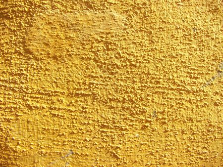 stucco: Bright sunny yellow texture on this stucco wall.