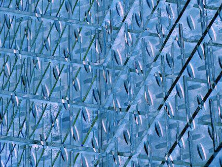 blue metallic background: A mashup of photos produces a metallic looking blue background.                  Stock Photo