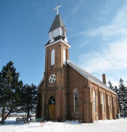 Pretty little brick country church in a snowy winter setting, Ontario, Canada. Stock Photo - 6176332