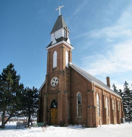Pretty little brick country church in a snowy winter setting, Ontario, Canada.                                Stock Photo - 6176332