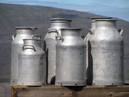 farming industry: A bunch of milk bottles waiting for collection outside a farm in western Iceland.
