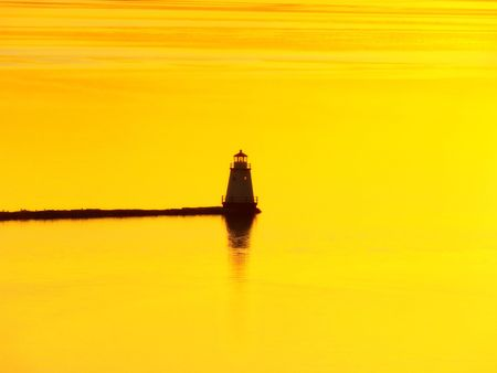 Sunset over a lighthouse on Lake Champlain, Vermont. Stock Photo - 6282908