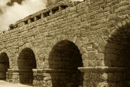 An ancient Roman aqueduct near Ceseara, Israel. Stock Photo - 8240332