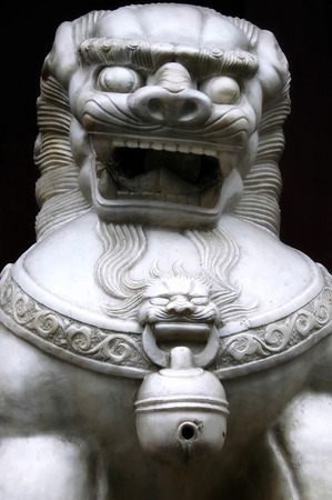 Lion guarding a bank in Shanghai, China