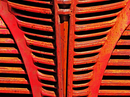 Grillwork on the front of a red vintage truck
