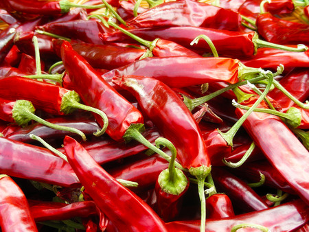 A basket full of really hot looking peppers in a market in downtown Seoul, Korea            Stock Photo