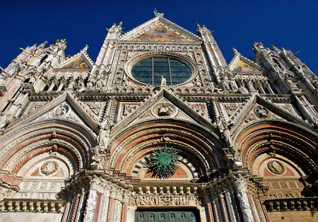 The amazing front of the cathedral in Siena, Italy