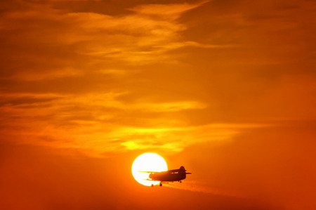 Honestly, the plane just flew into my sunset shot  Sunset in central Hungary  Stock Photo