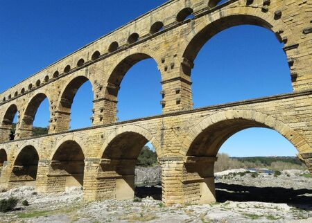 The ancient Roman aqueduct of Pont du Gard spanning the river Isere in southern France..