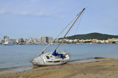 SAN ANTONIO-IBIZA-SPAIN-JANUARY-292013: boat swept by the storm of the previous day and stranded on the beach. Editorial