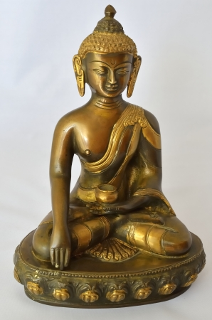 Metal statue of Buddha in a meditative state Stock Photo