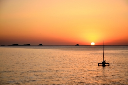 Output to surf the sunset on the island of Ibiza Stock Photo