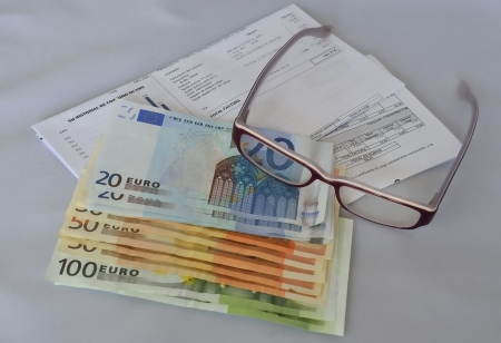 The value of money goes down, with the bills. Stock Photo - 18144434