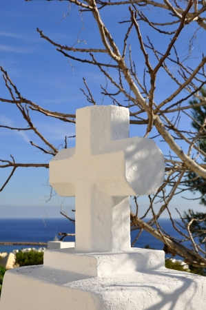 Symbol of the cross on top of a mountain