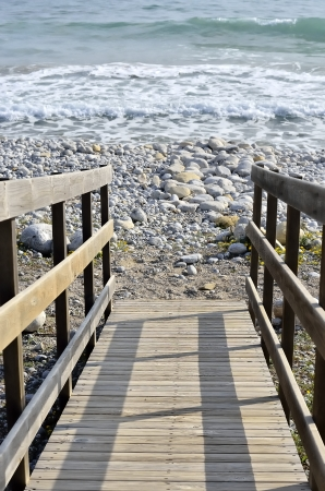wooden staircase that leads to the beach